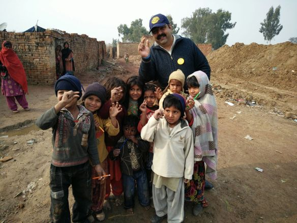 AG Nosherwan Khan with children in rural areas up in the mountains